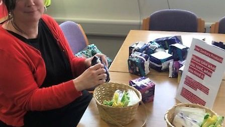Labour councillor Emma Corlett with the sanitary products they have placed in toilets at County Hall