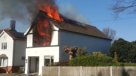 Flames pouring from the roof of the house in Station Road, West Runton at the weekend.Picture: DEAN