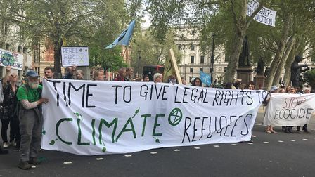 A group of Extinction Rebellion protesters in Parliament Square in Westminster, London yesterday