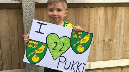 Oscar with his 'I love Pukki sign' which he took to Friday night's game. Picture: Katie Drewery