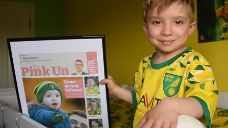 Four-year-old Norwich City super fan Oscar Drewery at home in Gorleston with his framed picture of h