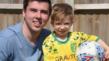 Four-year-old Norwich City super fan Oscar Drewery with his dad Joe. Picture: DENISE BRADLEY