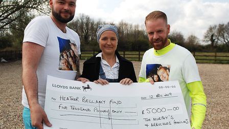 Andy Lucraft-Townley (left) and Chris Hayes with Heather Bellamy and a £5,000 donation from Arbuckle