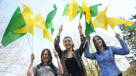 Green and yellow flags ready for the big match. From left, Emily Randall, Millie Sadler, and Rosanna