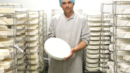 Jonny Crickmore with Baron Bigod brie made in the new cheese-making building at Fen Farm Dairy near