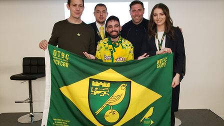 Lucas La Torre (middle), with, from left, Norwich City director Ben Smith, Norwich City Chief Operat