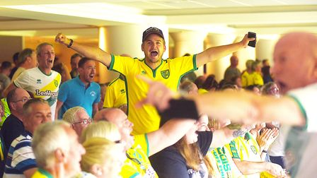 Norwich fans at a beamback of a match against Ipswich Town at Carrow Road in 2018. A beamback is bei