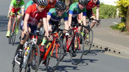Youth riders race into Olivet Way at the Fakenham Town Centre Races Picture: Fergus Muir