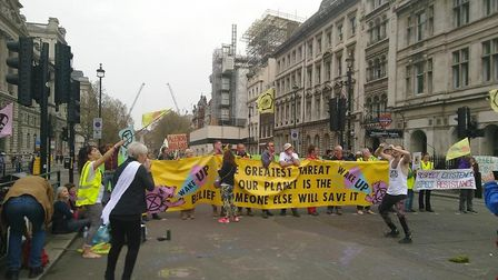 Protestors from the Norwich branch of environmental group Extinction Rebellion have gathered in Lond