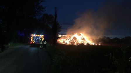 Fire engines on the scene of the straw stack blaze. Pic: submitted.