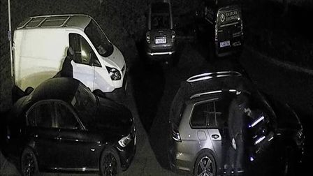 Three masked men were caught on video breaking into vans and stealing electrical equipment in Norwic