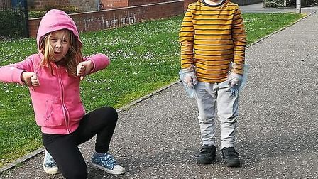 Evie Scott, 6, and Toby Scott, 5, are calling on dog owners to pick up dog poo. Picture: Contributed