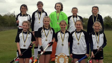 Harleston Magpies' Under-12 girls won their regional event on home soil to qualify for the national