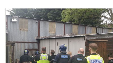 Officers raid one of the cannabis factories, in a cast iron outbuilding Picture: Cambridgeshire pol