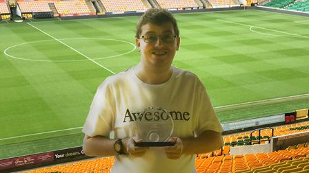 NCFC Fan of the Year, Jacob Bowles, at Carrow Road with his 'Fan of the Year' award. Picture: Ella W