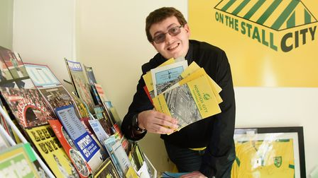 Jacob Bowles on his Norwich City Football Club memorabilia market stall called On The Stall City. Pi