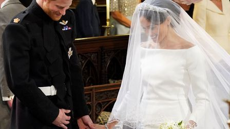 Prince Harry and Meghan Markle during their wedding at St George's Chapel, Windsor Castle. Photo: PA