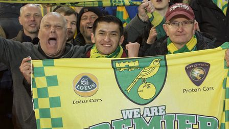 Norwich City fans celebrate after winning promotion to the Premiership after the Sky Bet Championshi