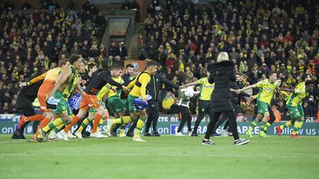 Norwich City players celebrate after winning promotion to the Premiership in the Sky Bet Championshi
