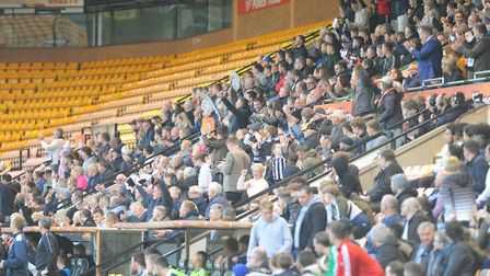 A decent crowd gathers in the Main Stand at Carrow Road