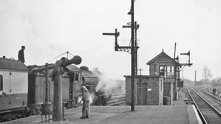 A man on the platform at Melton Constable Railway Station in 1958. View eastwards, towards Great Ya