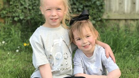 Lacey Moore with her little sister Lexi-Alayah wearing their Great Ormond Street Hospital T-shirts.