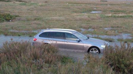 Coastguard volunteers helped the occupants of a car on a flooded section of Beach Road, Brancaster.