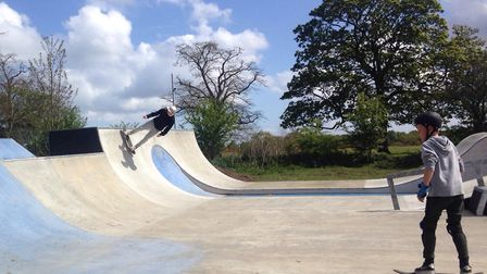 Experienced skaters worked with younger riders to help them with balance on the board and learn to s