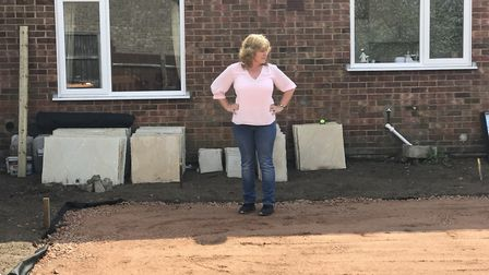 Fiona Lever in her garden which her workman abandoned. Photo: Archant
