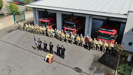 A minutes silence is observed at carrow fire station in Norwich to mark Firefighters Memorial Day. P