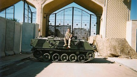Phillip Gough at the back gate of Basra Palace in 2003 Picture: Phillip Gough