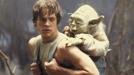 Luke Skywalker undergoing Jedi training with Yoda. Yoda the puppet, voiced by Frank Oz, was more con