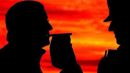 A motorist is stopped by police to take a breath test. Picture: John Giles/PA Wire