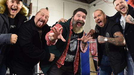 WWE World Champion Mick Foley, centre, in Norwich, pictured with the Knight family, as he will be ap