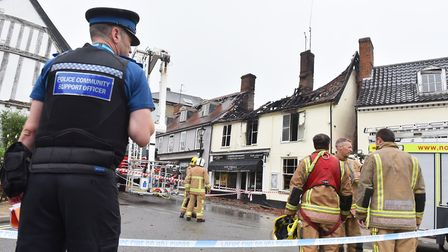 Fire crew attend the scene of a fire at a Newsagents on Market Place, Halesworth.Picture: Nick Butch