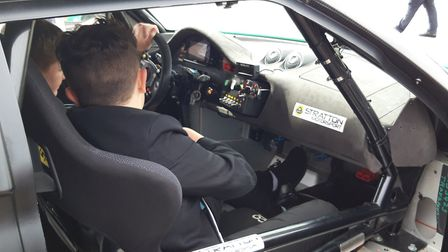 Students at Open Academy in Norwich get an in depth look at racing cars brought along to a motorspor