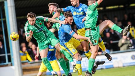 King's Lynn Town's central defenders Rory McAuley and Ryan Fryatt in the thick of the action during