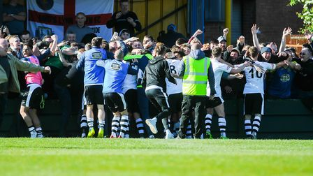 King's Lynn Town players and fans celebrate a famous victory Picture: Ian Burt
