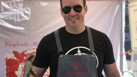 Chris Woodget from Walshingham farm shop with their special garlic leaf sausage, at Aylsham's sausag
