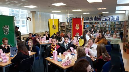 Long Stratton High School's Harry Potter themed fancy dress afternoon in the library. Students share