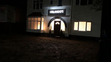 The property at night, with Orlando's name illuminated. Photo: Submitted