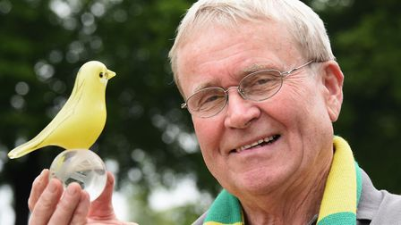 Langham Glass owner Paul Miller with the Norwich City glass canary special edition he has designed t