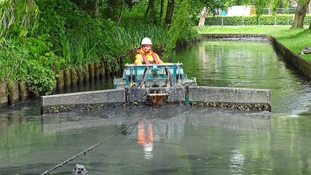The silt dredger at work on the Gaywood River through The Walks in King's Lynn Picture: BCKLWN