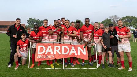 Dardanites pose with the men's open trophy after an exciting day's rugby sevens at Scottow Picture: