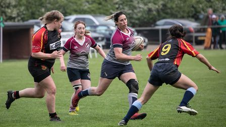 West Norfolk Ladies run the ball at Scottow Picture: HYWEL JONES