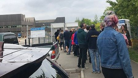 A queue for the parking meter at the Norfolk and Norwich University Hospital. Picture: Jennifer Good