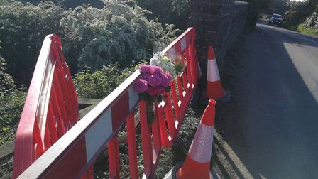 Floral tributes have been left at the scene of the fatal accident on the B1145 at Cawston, Norfolk.