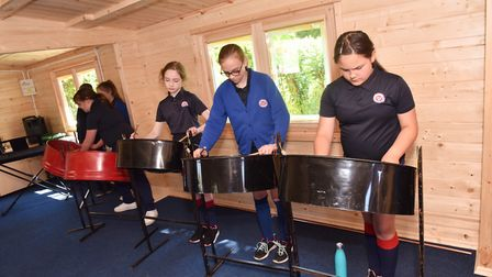 Pupils at Iceni Academy in Hockwold play a piece on steel pans in their new dedicated music room. Pi