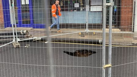 Workers getting things ready to repair the sinkhole which opened up in the High Street of Sheringham