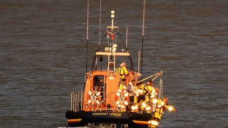 Lowestoft lifeboat crew prepare to carry out the rescue off Pakefield. Picture: RNLI / Mick Howes
